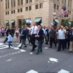 a large crowd marched behind Leon Goldenberg with New York City Mayor, Bill DeBlasio